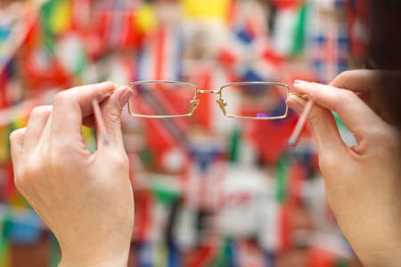 A look through the glasses at flags of different countries. Banque d'images