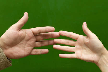 Male and female hand touch each other, the concept of love in school.