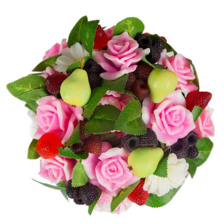 Handmade soap bouquet in form of flowers pears raspberries blackberries strawberries top view.