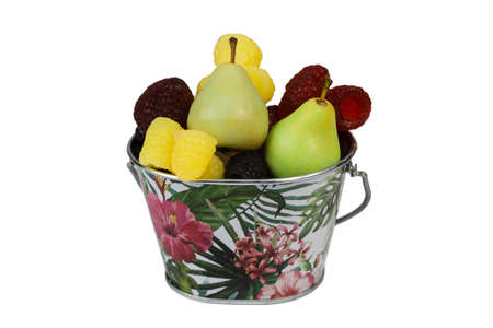 A full bucket of soap in the form of pears blackberries strawberries and raspberries on a white background. Isolated