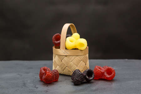 Handmade soap basket in the form blackberries and raspberries on a black backgroun. 版權商用圖片
