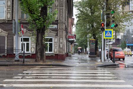 Russia, Irkutsk-July 30, 2021. City street in rainy weather, editorial. 新聞圖片