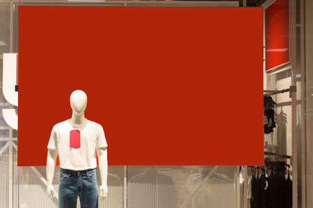 Men's manicure on a red advertising banner in the store, copy the space.
