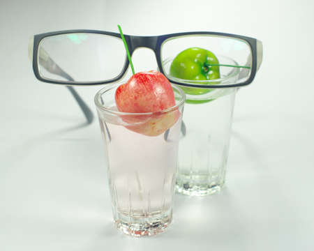 glasses and apple