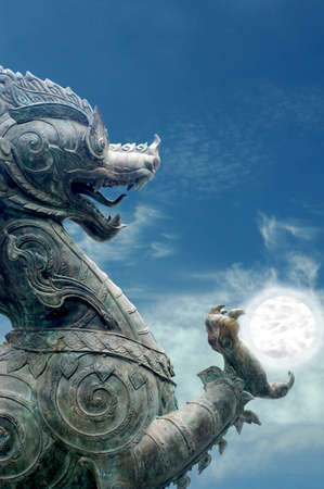 Metal lion holding a crystal ball and sky