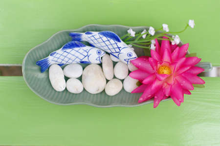 Lotus bloom in the plate on the table Stock Photo - 15095381