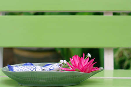 Lotus bloom in the plate on the table