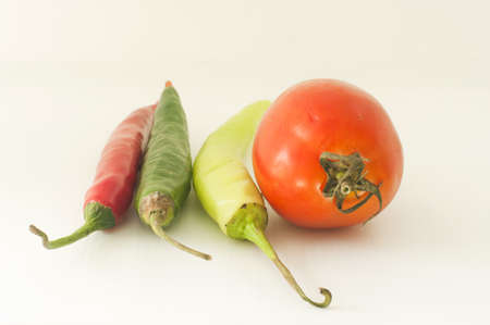 Photo provided white background, tomatoes and peppers photo
