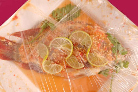 nilotica: Steamed fish topped with lemon pepper in packet for sell