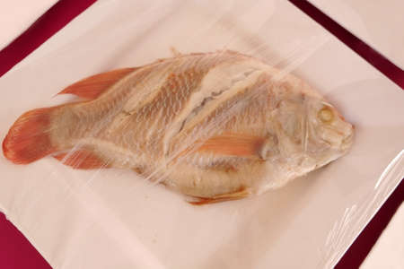 steamed Fish in packet for sell photo