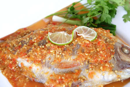 Steamed fish topped with lemon pepper photo