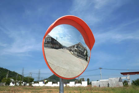 Convex mirror for junction with blue sky