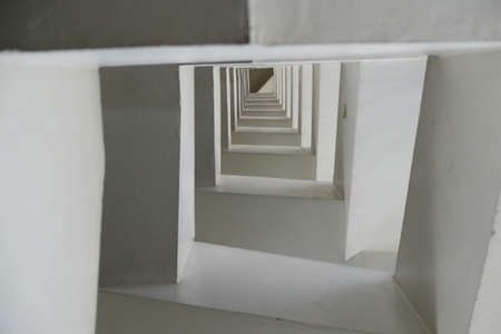 A square stairway in tall buildings photo