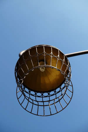 Gold bird cage as Lamp against blue sky Stock Photo - 27524872
