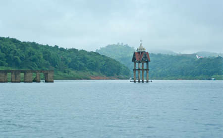 house float on water: temple in water on Sangkhla Buri, Thailand