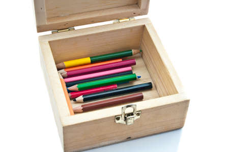 Colorful pencils in wood box on white background Stock Photo
