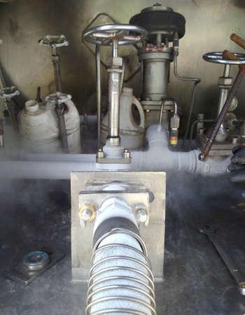pipe smoking: Cold metal pipe smoking from transferring liquid nitrogen Stock Photo
