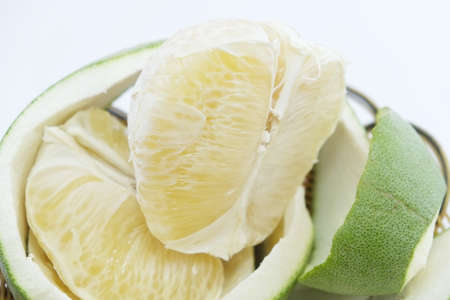 citrus maxima: Green pomelo citrus fruit on wood Basket white background Stock Photo