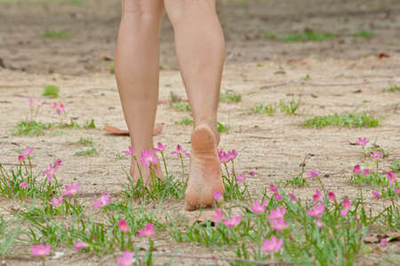 birthmark: Walking on flower garden Stock Photo
