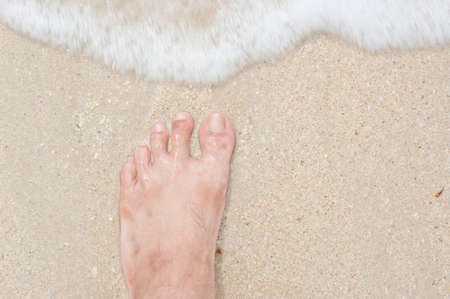 beach feet: Vacation on ocean beach, feet on sea sand Stock Photo