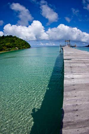 trat: beautiful long wooden bridge tropical island beach - Koh Kood, Trat Thailand Stock Photo