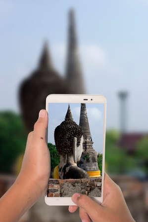 travel concept take photography buddha statue at Ayutthaya Thailand by phone Stock Photo