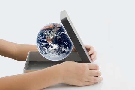 figurative: boy open Earth in box