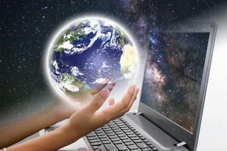 Earth and Computer Notebook Stock Photo