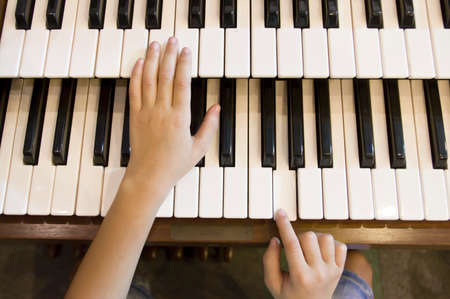 little boy to play the piano Stock Photo