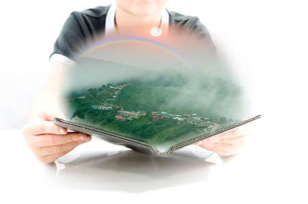 Smart kid learning. Natural phenomenon rainbow with 3D book for new experience Stock Photo