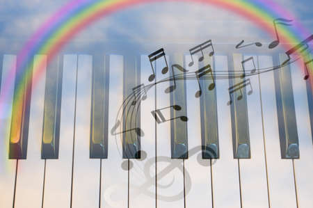 Close-up of Piano Keyboard centred on sky space and rainbow Stock Photo