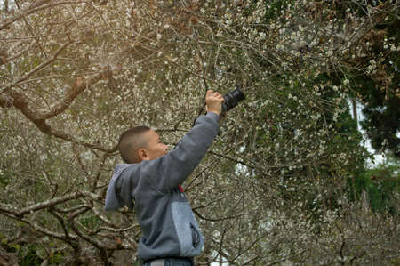 Asian boy learning to shoot photo