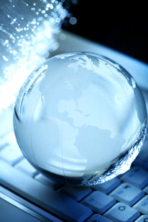 Crystal globe on keyboard photo