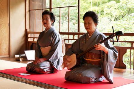 Niigata, Japan - Oct 29, 2015 : Japanese traditional singer and musician show in tea ceremony Editorial