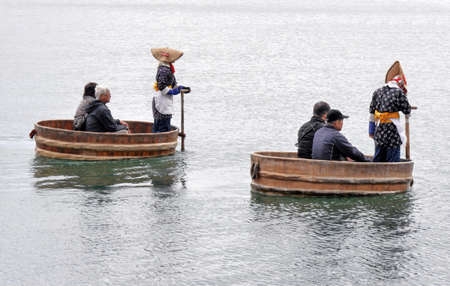 Sado Island, Niigata, JapanOct 30, 2015 - Tarai bune tub boat service for tourist in Sado Island Niigata Japan Editorial