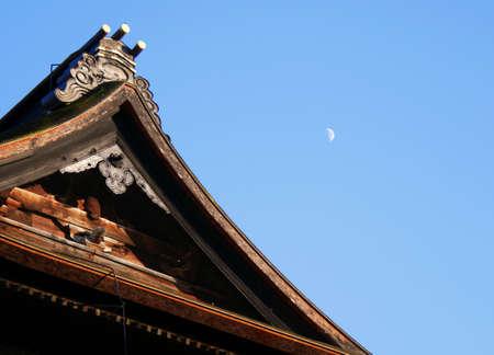 Zenkoji temples roof with half moon and blue sky Nagano Japan Stock Photo