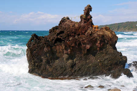 Torii on the rock in the sea at Sado island Niigata Japan Stock Photo
