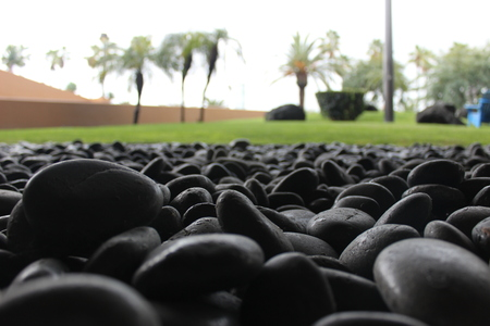 Smooth Black Stone Landscaping