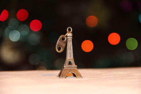 small world: Miniature Eiffel Tower in Bokeh lights Stock Photo
