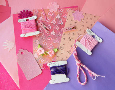 card making: Pastel pink and purple card making composition  threads, craft paper, craft elements