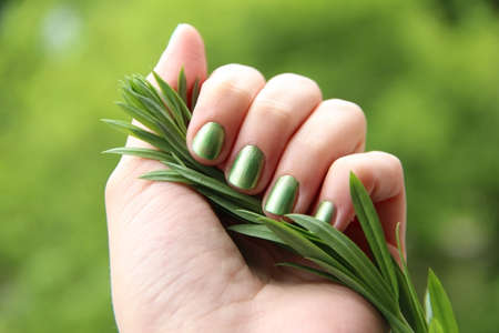 Eco friendly nail polish  mint coloured manicure photo