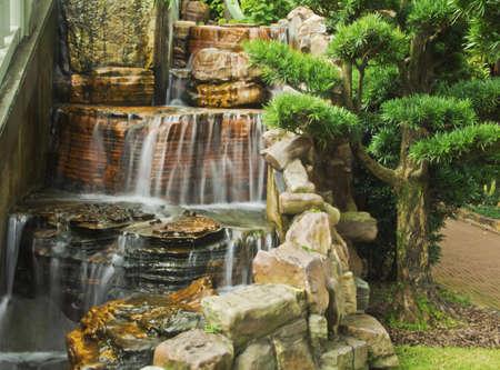 Beautiful fountain in Chinese Classical Garden Nan Lian Garden in Hong Kong situated on the Kowloon Island Blurred motion
