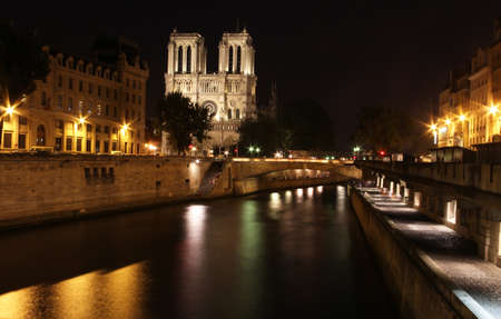 The famous Notre Dame cathedral  in Paris, France photographed at night photo