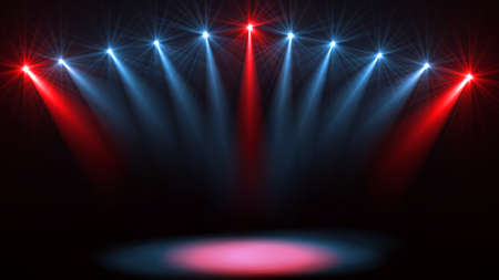 Stage lights. Several projectors in the dark. Purple spotlight strike through the darkness