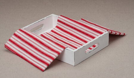 Tray With Folded Napkin On Natural Linen Background photo