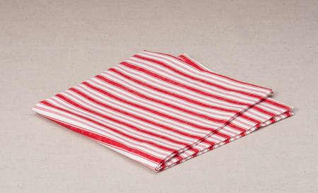 Red White Folded Napkin On Natural Linen Background photo