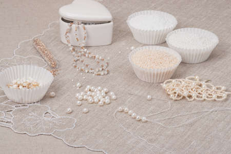 Beads Jewelry On Natural Linen Background. Hand Made photo