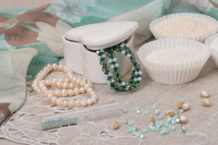 seed beads: Beads Jewelry On Natural Linen Background. Hand Made Stock Photo