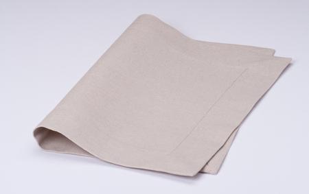 servilleta: Natural servilleta de lino sobre fondo blanco