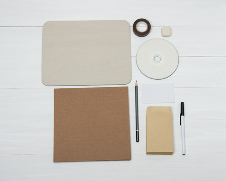 Business Identity Mockup Item Set On White Wooden Desk photo